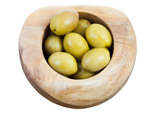 top view of green olives in wooden bowl isolated