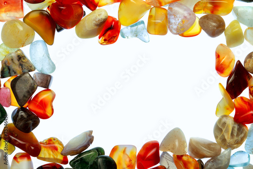 collection of beautiful precious stones against white background