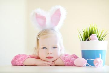 Adorable girl wearing bunny ears on Easter