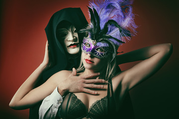 Portrait of a fashion couple with venetian masks