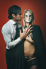 Fashion man with masked woman