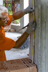 Construction worker placing slab formwork beams
