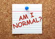 The question Am I Normal? on card pinned to a notice board