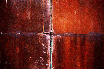 rusty metal with old cracked paint of different colors