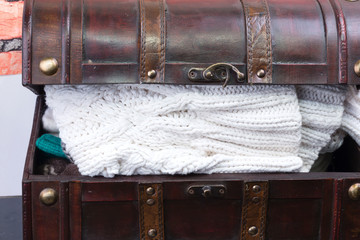 old trunk with a  knitted clothes things