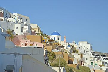 oia in santorini island, white houses and church