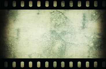 Grunge scratched film strip background.
