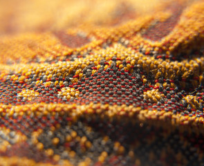 Extreme closeup on orange oriental fabric