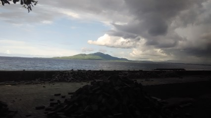Dark sky and mountain in the sea