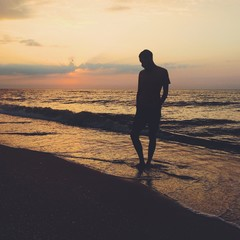 Lonely man on the sea beach