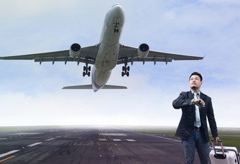 young business man standing in airport runways with belonging lu