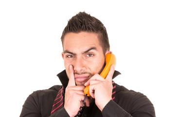 closeup portrait of handsome hispanic man talking on corded