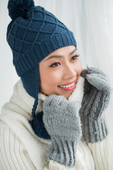 Asian woman in warm clothes