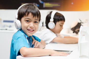 Little boy with headset in classroom