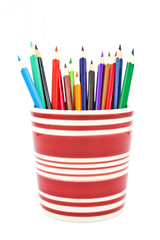Colored pencils isolated on white background.