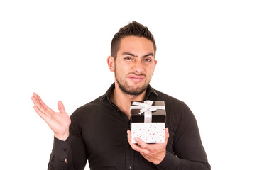 unimpressed young man holding a gift box