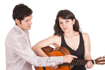Beautiful female guitar student and teacher