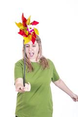 Blonde girl blowing grinder wind