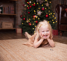 Little girl under the Christmas tree