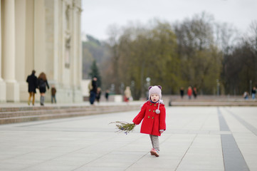Little girl holding willow branches on Easter