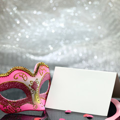 Vintage carnival mask and white blank card
