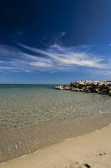 Spiaggia, scogli e mare cristallino