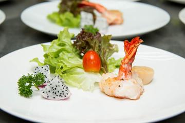 shrimp prawns with fresh lettuce in plate