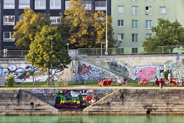 People have a break at the pier of the Danube Canal - Vienna