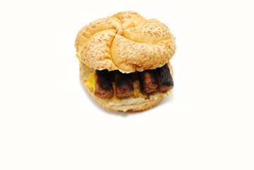 An Egg Sandwich Topped with Sausage