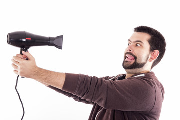 Scared guy with hair dryer