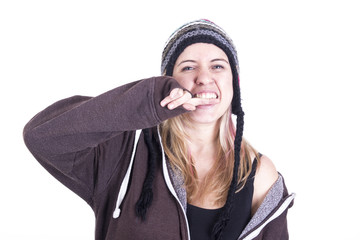Blonde girl wearing bonnet biting finger