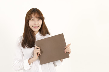 Young Asian Woman Holding a Blank Brown Sign