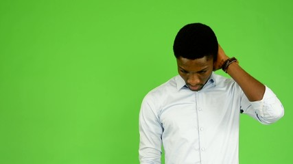 young handsome black man thinks - green screen