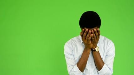 young handsome black man cries  - green screen - studio