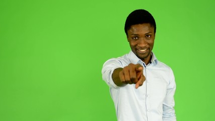 black man points to camera - green screen - studio