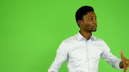 black man oversleep and confused - green screen