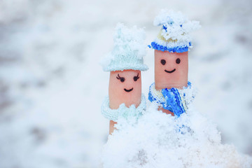 Finger art of a Happy couple on the background of snow.