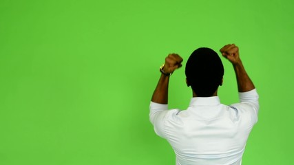 young handsome black man rejoices (back) - green screen
