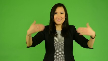 asian woman welcomes - green screen studio