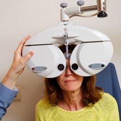 Examining the eyes of a woman