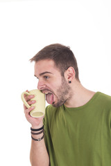 Portrait of guy licking coffee cup
