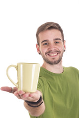 Portrait of smiling guy showing coffee cup