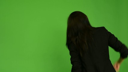 attractive asian woman rejoices (back) - green screen