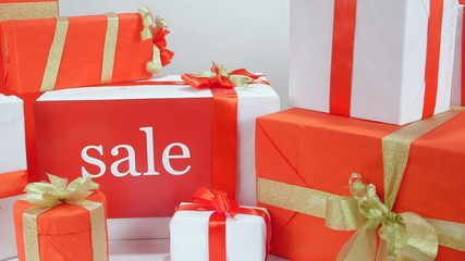 Stack of red white gift boxes with word Sale