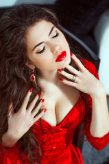 Beautiful girl model portrait. Makeup. Red lips. Manicured nails