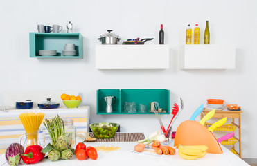 A kitchen with healthy food and utensils