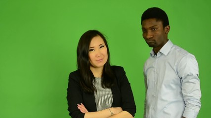 Couple disagree - black man and asian woman - green screen