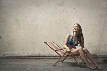 Girl sitting in a beach chair