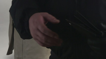 Pickpocket taking wallet from a womans pocket