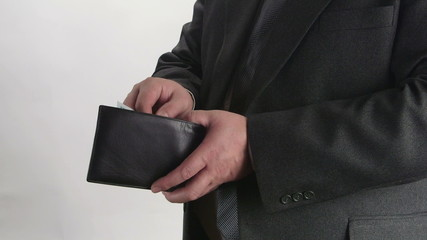 Business person takes out his wallet